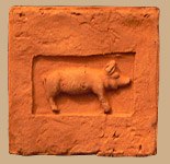 Brick tile with custom pig design