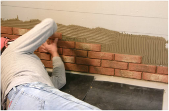 Installing brick tile in thin set on a wall