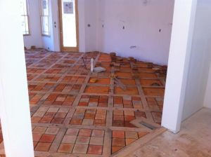Inglenook brick tile installation in progress