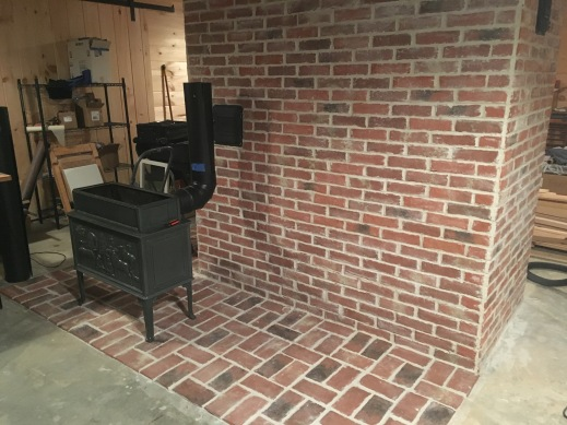 Wood stove with brick tile veneer