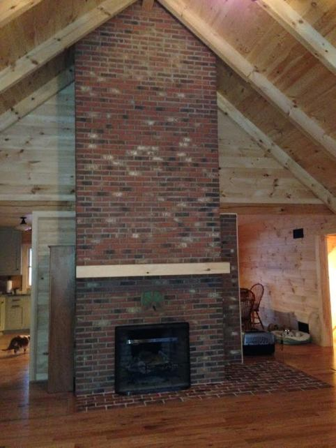 Thin brick clad fireplace