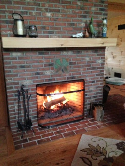 Brick tile fireplace with shamrocks